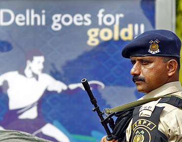 A Central Reserve Police Force trooper stands guard outside the Jawaharlal Nehru Stadium in Delhi