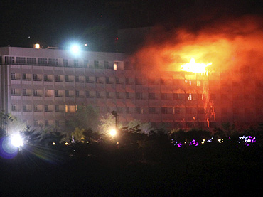 Smoke and flames rise from the Intercontinental hotel during a battle between NATO-led forces and suicide bombers and Taliban insurgents in Kabul on Wednesday