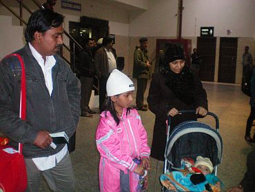 Feroze and Issa with their children on their arrival from Libya in New Delhi
