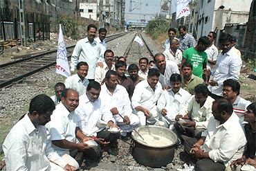 Telangana Joint Action Committee members organise 'rail roko' near Secunderabad station on Tuesday