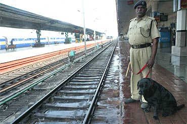 A security personnel patrols at a platform in Hyderabad