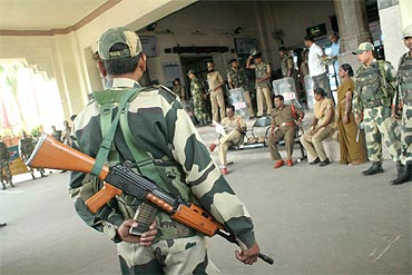 Security personnel stand guard at the Hyderabad station