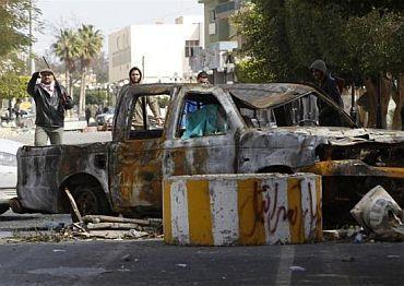 A Libyan gunman opposed to leader Muammar Gaddafi mans a roadblock in the city of Zawiyah