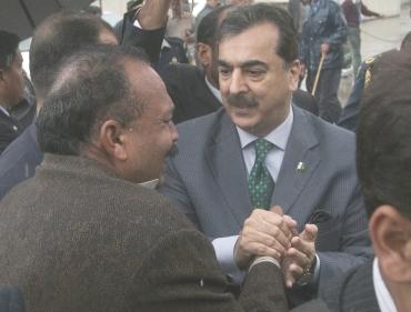 Pakistan's Prime Minister Yusuf Raza Gilani consoles relatives of slain Shahbaz Bhatti