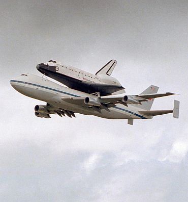 Photo taken on October 9, 1983. NASA's newest space shuttle, Discovery, makes a triumphant fly-by of the Florida Space Coast and the Kennedy Space Centre runway before landing