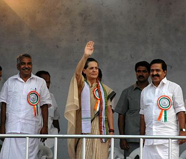 Congress chief Sonia Gandhi with Oomen Chandy , former chief minister and Leader of the Opposition in the state assembly, and Kerala Pradesh Congress Committee (KPCC) president Ramesh Chennithala