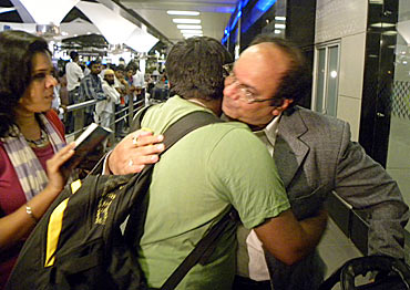 An Indian rescued from Libya reunites with his family at the Mumbai airport