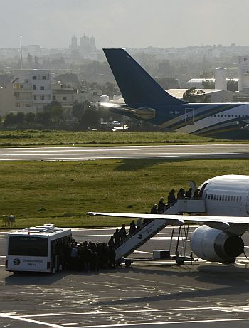 Passengers board a flight out of Tripoli