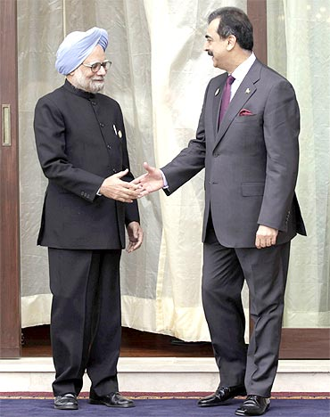 A file photo of Prime Minister Manmohan Singh with Pakistan Prime Minister Yusuf Raza Gilani