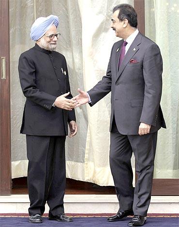 A file photo of Prime Minister Manmohan Singh with Pakistan Prime Minister Yusuf Raza Gilani