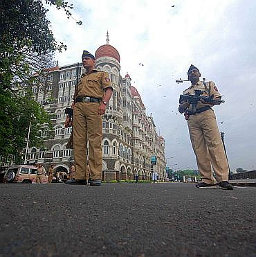 Policemen guard the Taj Mahal Hotel in south Mumbai, which was attacked on 26/11