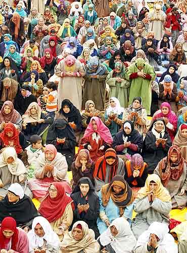 A group of women pray in Srinagar