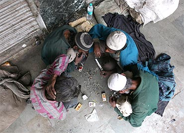 Drug addicts smoke 'smack' (low quality heroin) in the old quarters of Delhi