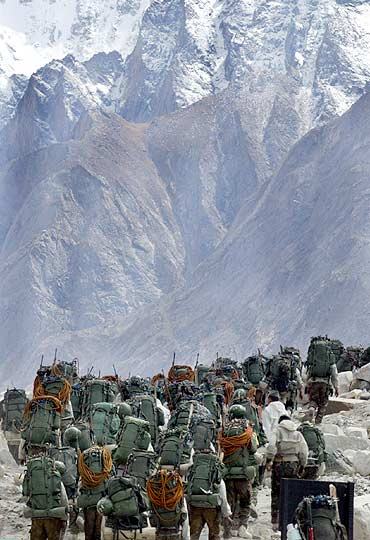 Indian soldiers march during training at Siachen Glacier.
