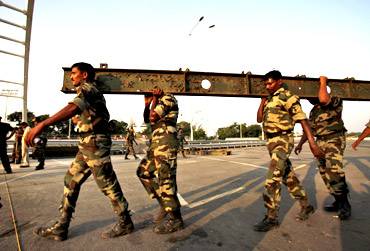 The Indian Army rebuilds a collapsed pedestrian bridge before the Commonwealth Games