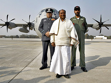 Defence Minister A K Antony and Air Chief Marshal P V Naik pose with the Super Hercules aircraft
