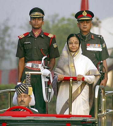President Pratibha Patil reviews a guard of honour in Chennai