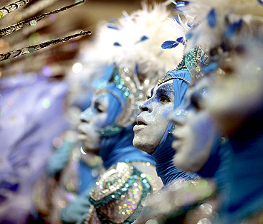 Revellers of the Portela samba school participate in the annual Carnival parade