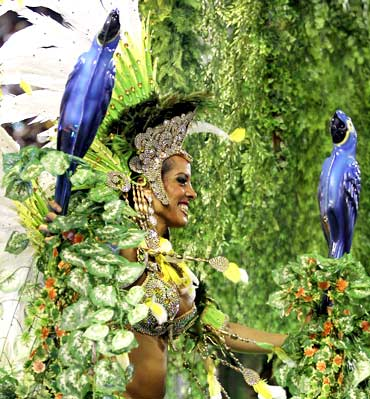 A reveller of the Portela samba school participates in the annual Carnival