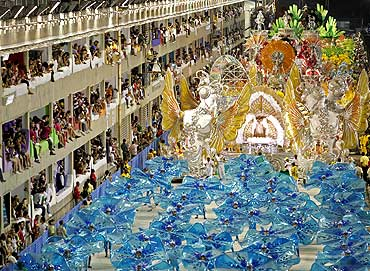 Revellers of the Imperatriz Leopoldinense samba school participate in the annual carnival parade