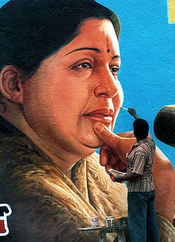 A party worker gives finishing touches to a wall painting of J Jayalalitha