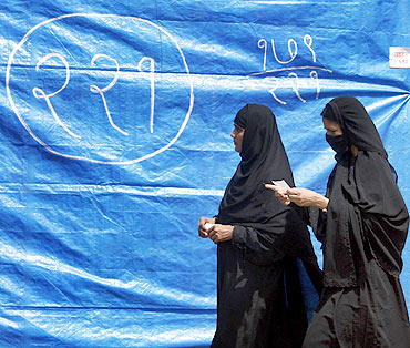 Muslim women search for their voting booth at polling centre during the 2009 general elections, in Mumbai