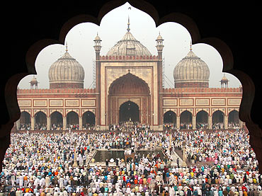 Muslims perform the Eid al-Adha prayers at the Jama Masjid in the old quarters of Delhi