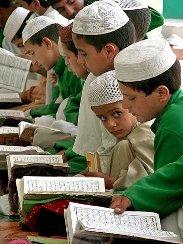 Muslim boys read the Koran at a madrasa in Jammu
