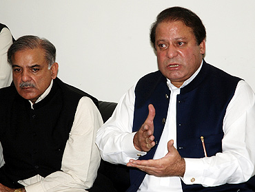 Nawaz Sharif (right), with his brother  Shahbaz Sharif, at a press conference in Lahore