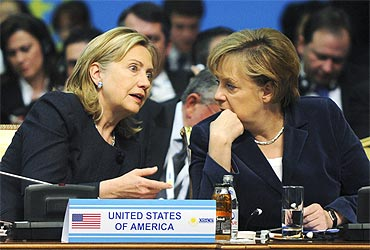 US Secretary of State Hillary Clinton with German Chancellor Angela Merkel