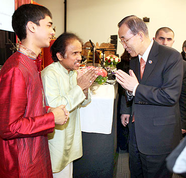UN Secretary-General Ban Ki-moon greets violin maestro L Subramaniam and son Ambi at the UN headquarters