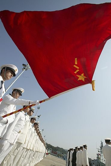 Chinese People's Liberation Army naval troops stand in attention during the annual rotation of military personnel in Hong Kong