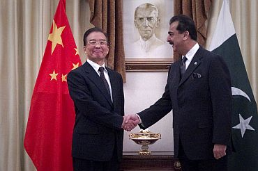 Pakistan's Prime Minister Gilani shakes hand with his Chinese counterpart Wen before a meeting in Islamabad