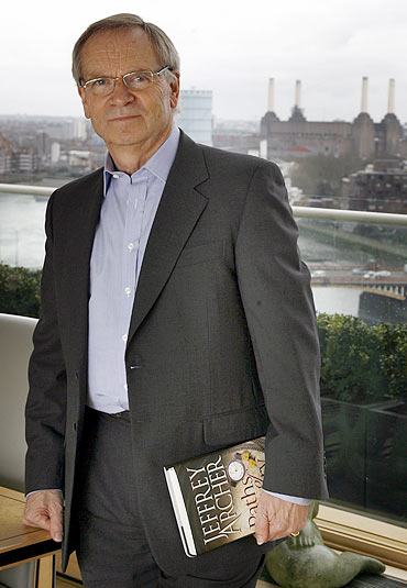 Jeffrey Archer poses for a photograph at his apartment in London
