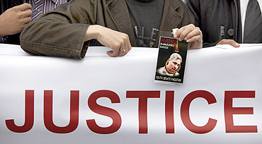 A man holds a photograph of US national Raymond Davis during a rally in Islamabad