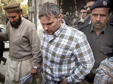 Davis is escorted by police officials near a Lahore court