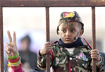 A boy attends a protest against Muammar Gaddafi in Benghazi