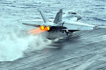 An F/A-18F Super Hornet launches during flight operations aboard the aircraft carrier USS Enterprise in the Red Sea