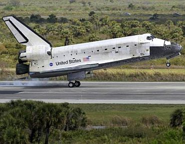 The space shuttle Discovery taxis to a stop after landing at the Kennedy Space Center in Cape Canaveral, March 9
