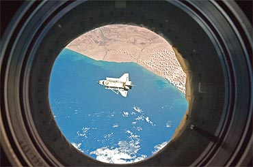 Discovery as seen through a window aboard the ISS