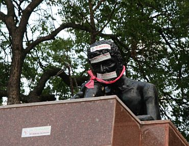 Telangana protestors desecrate a statue in Hyderabad during the 'Million March' on Thursday