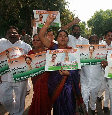 Telangana Congress law makers protest in front of the AP assembly on Wednesday