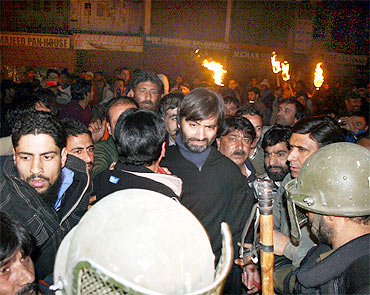 Security personnel detain Yasin Malik with other JKLF activists in Srinagar on Friday
