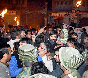 Security personnel detain Yasin Malik with other JKLF activists in Srinagar on Friday.