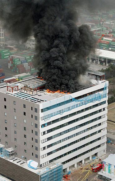 An office building burns in Tokyo after an earthquake