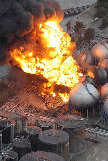 Natural gas storage tanks burn at a facility in Chiba Prefecture