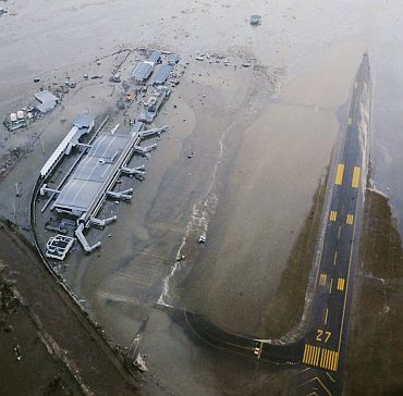 An aerial view of a tsunami swamped Sendai Airport in northeastern Japan