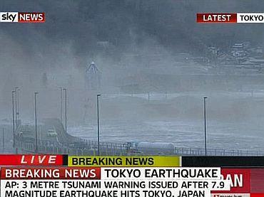 Video grab shows tidal waves lashing the Japanese coastline
