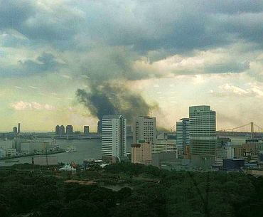 A plume of smoke rises over Tokyo