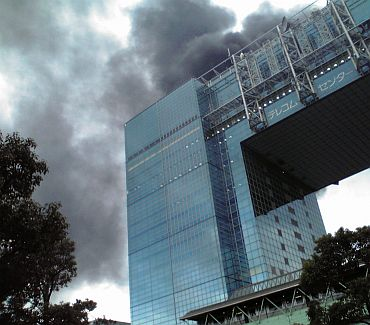 A building burns after an earthquake in the Odaiba district of Tokyo